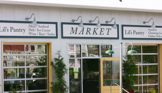 Gooseneck Sign Lighting Reveals This Coastal Market