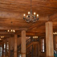 Vintage Chandelier Focal Point in Lobby of Rustic Mountain Inn