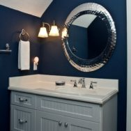 Vintage Wall Sconce Adds Elegance to Bold, Blue Bathroom
