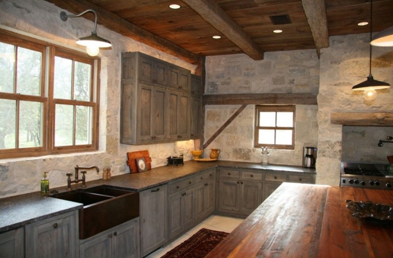 Industrial barn lights shine in a rustic industrial for Barn style kitchen cabinets