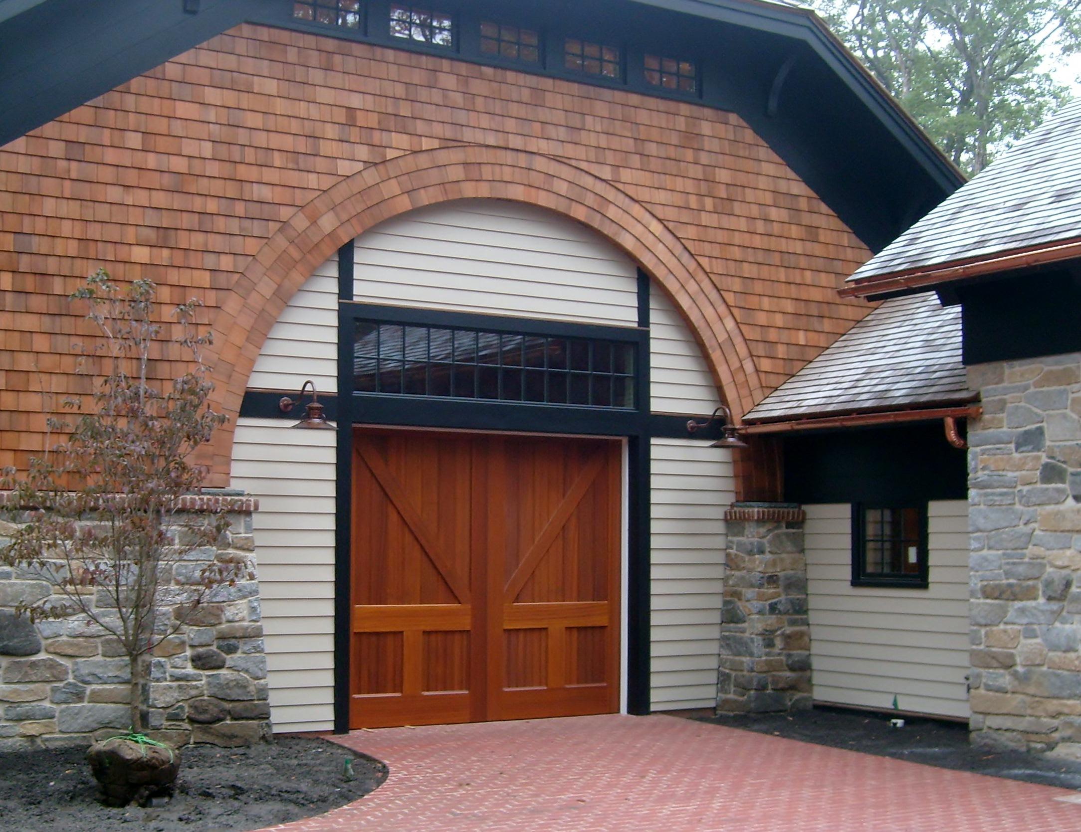 Gooseneck barn lights highlight 1850s style barn turned for Exterior garage light fixtures