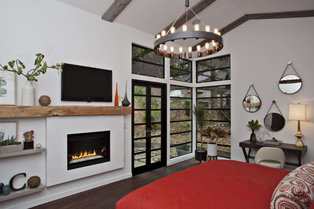 modern bedroom chandeliers. This Master Bedroom Features Some Warm, Rustic Touches Such As The Fireplace With A Reclaimed Barn Beam Serving Mantel Plus Hardwood Floors An Modern Chandeliers