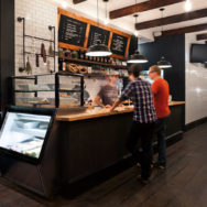 Professional's Corner | Black Bomber Porcelain Pendants Make Statement in New York Deli