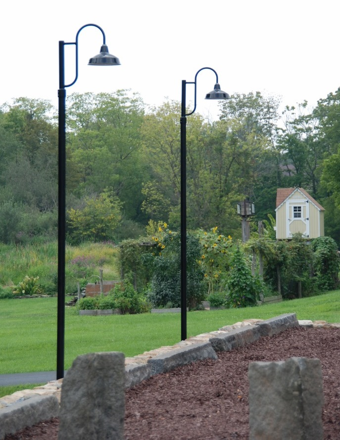 Gooseneck post mount lights make subtle old world statement blog the avalon single post mount decorative exterior light is one of our most popular mid sized shades and features a rugged porcelain enamel finish mozeypictures Gallery