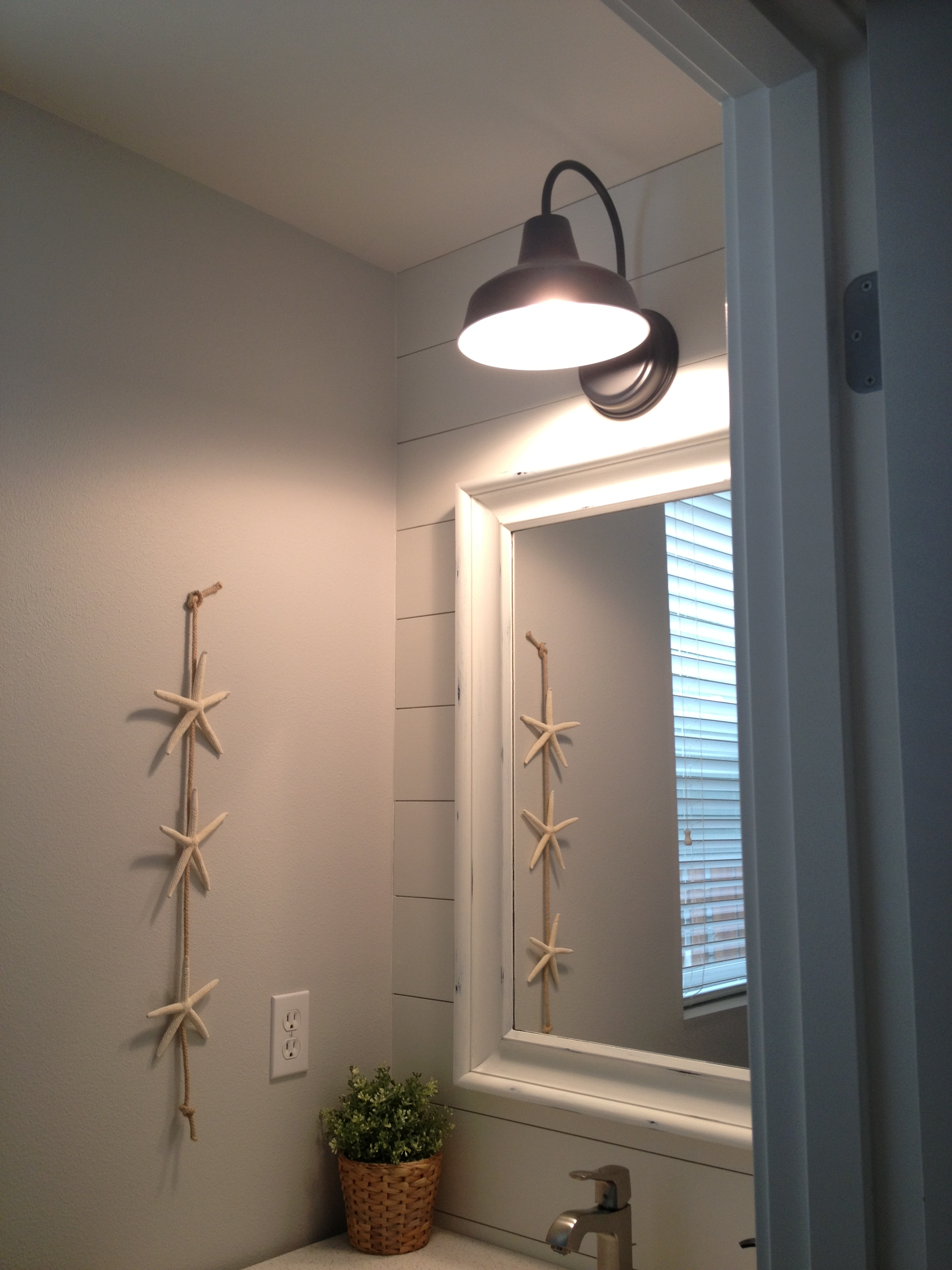 Barn wall sconce lends farmhouse look to powder room for Lighting for a bathroom
