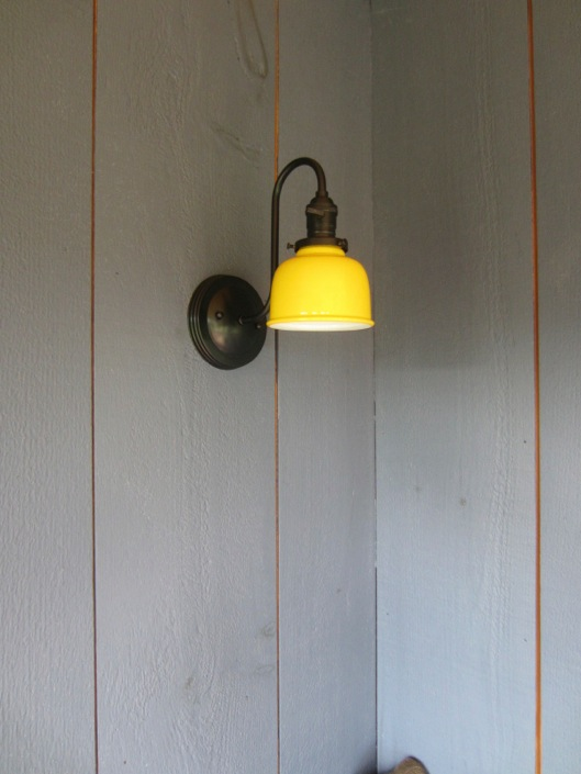 featured customer barn wall sconce combines rustic barn look with modern finish