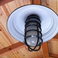 Porcelain Enamel Lighting Adds Glam to Mediterranean Potting Shed