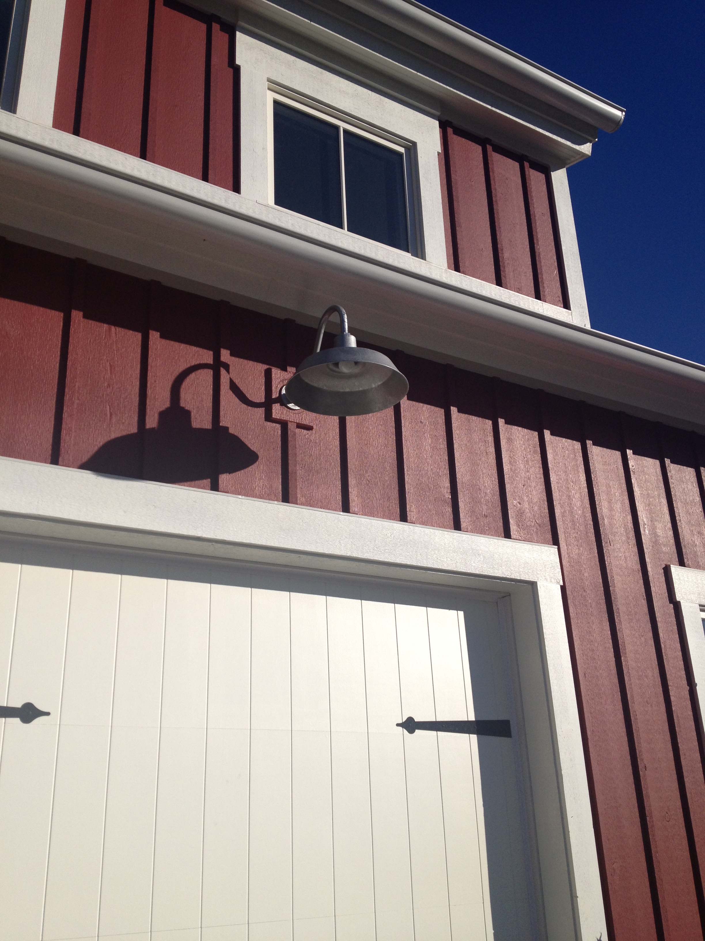 Red Farmhouse with Galvanized Barn Lights from BarnLightElectric.com