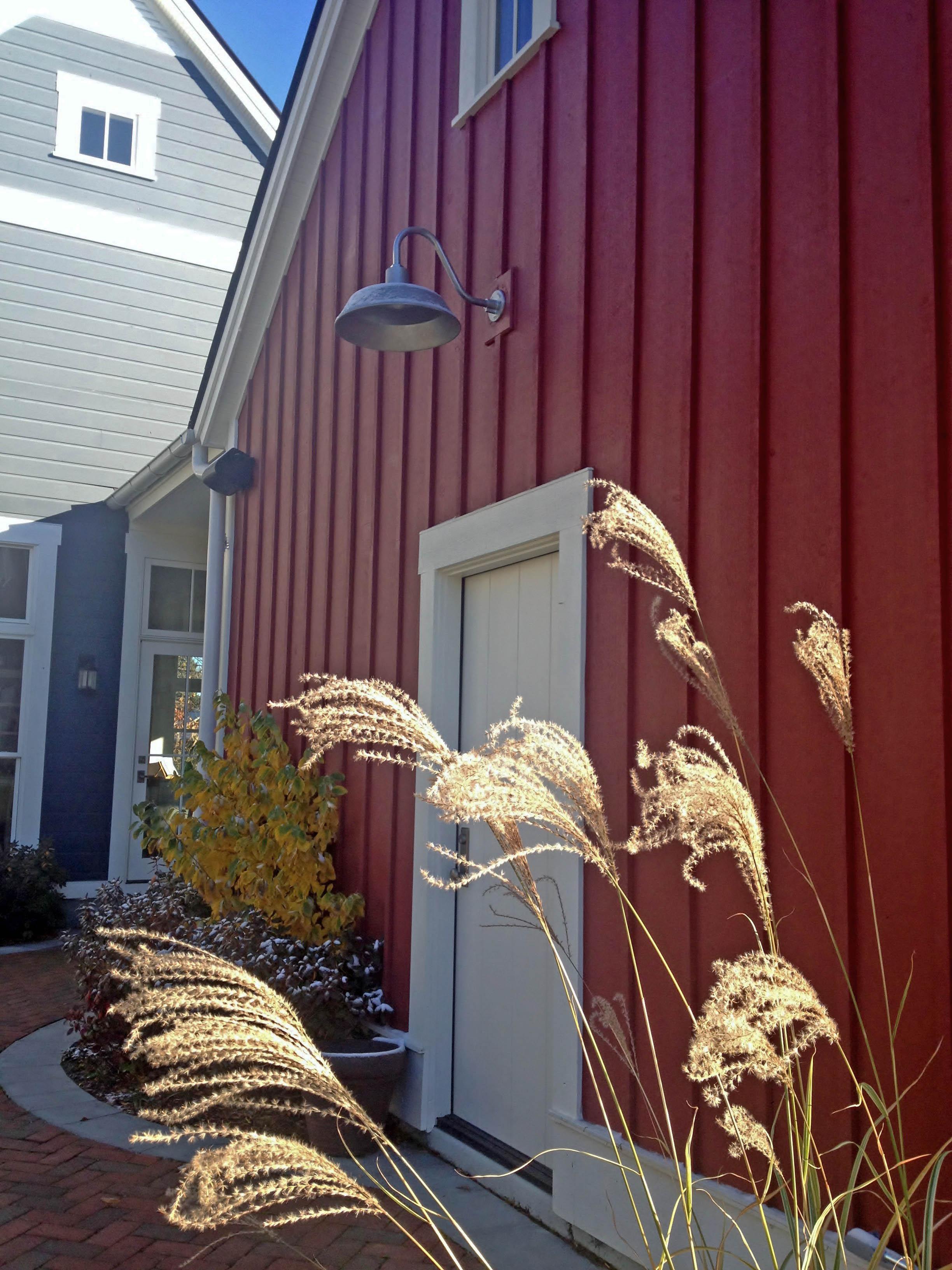 Original Barn Lighting lights up a modern farm home.