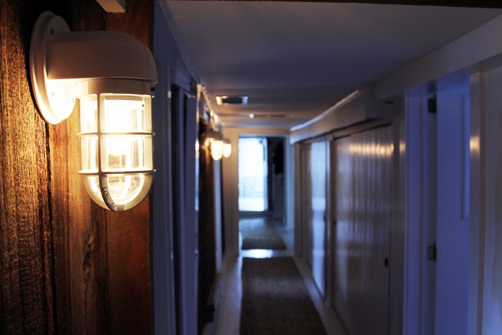 Rustic Wall Sconces Line Main Hallway in Converted Dairy Barn Blog BarnLightElectric.com