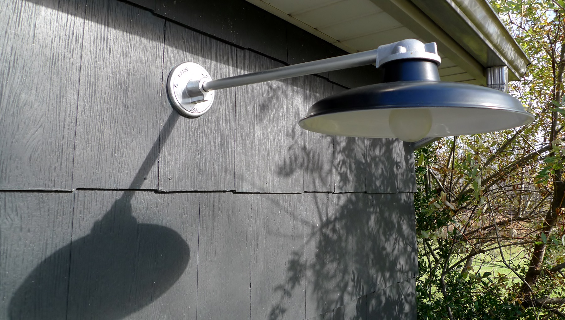 Classic outdoor gooseneck lighting for a modern ny for Outside lawn lights
