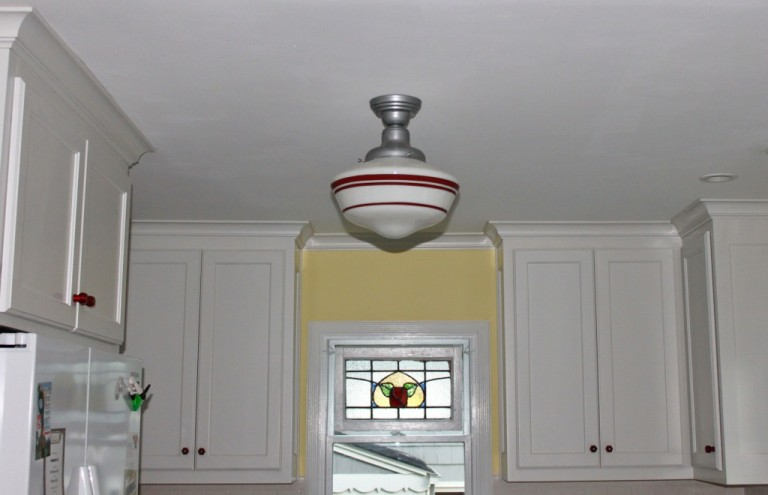 schoolhouse pendants crowning touch in tudor kitchen