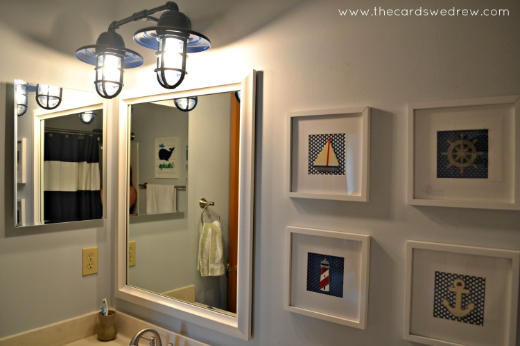 Rustic wall sconces add nautical splash to bathroom