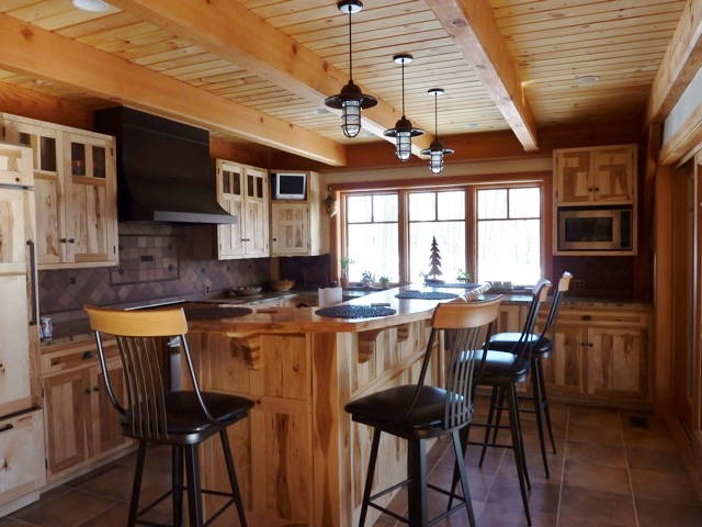 Rustic lighting adds style to homes from traditional to modern these atomic industrial guard cord hung pendants provide a beautiful accent in this industrial farmhouse kitchen and complement the abundance of wood in the mozeypictures Image collections