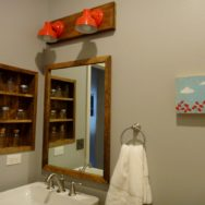 Wall Sconce Lighting Brings Pop of Color to Bathroom Remodel