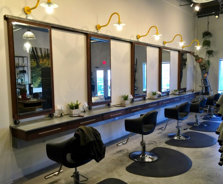 Gooseneck wall lights exude modern style in salon blog for Modern salon stations