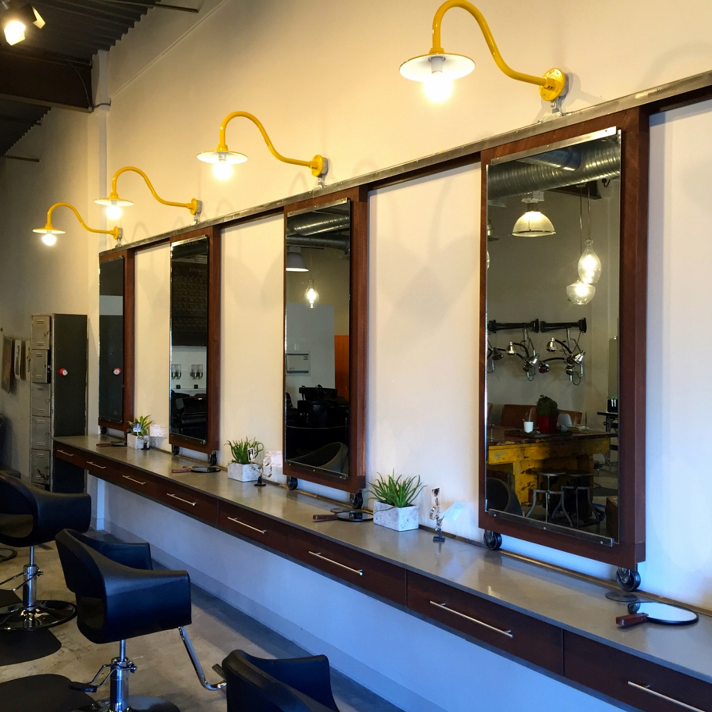 gooseneck wall lights exude modern style in salon blog