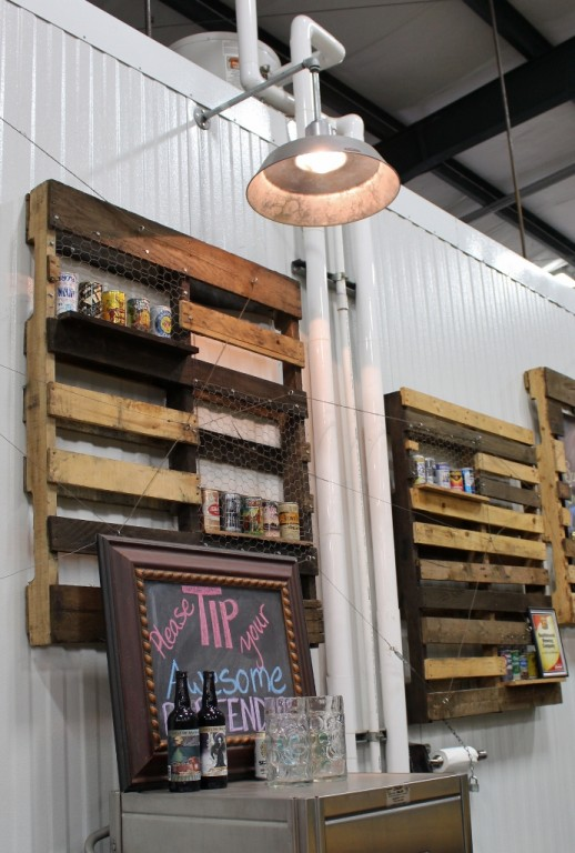 Craft brewery imbues space with industrial lighting blog smith wanted to embrace and enhance the industrial feel of the space so he chose barn style lighting and added pallet shelving and old beer cans to help set aloadofball Image collections