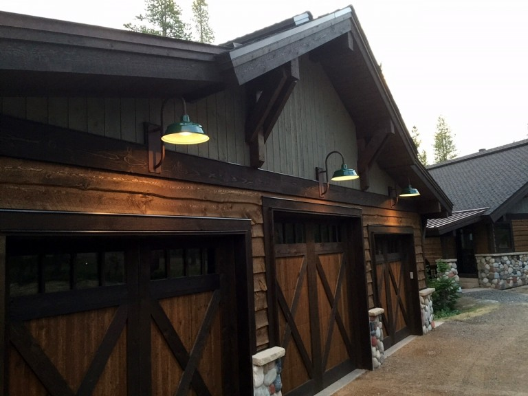 craig created a rustic cabin look to his new home and garage shown here with barn style doors and stacked stone pillars the garage is used for the family barn lighting create rustic