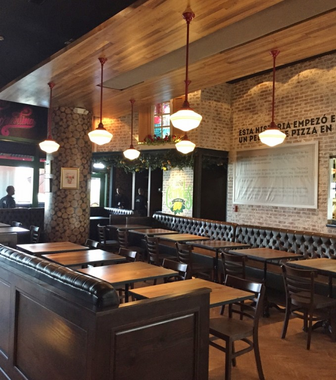 The Table Tops Are Custom Made From Acacia Wood And A Special Wood Fired  Oven Was Brought Over From Italy. The Pair Chose Schoolhouse Lighting As  The ...