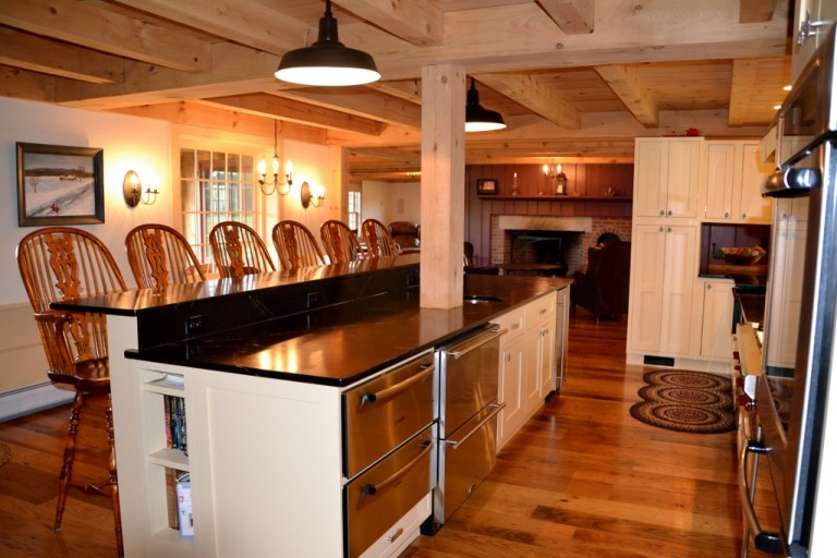Barn lights blend old new in post beam farmhouse for 9x12 kitchen ideas