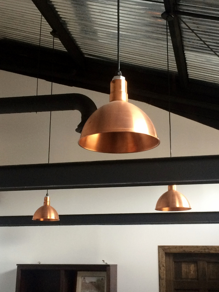 Copper Pendant Lighting Elevates Industrial Office Space