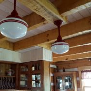 Featured Customer | Schoolhouse Lighting Accents Log Home Kitchen with Vintage Style
