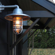 Featured Customer | Galvanized Wall Sconce Pops Against Black Garage