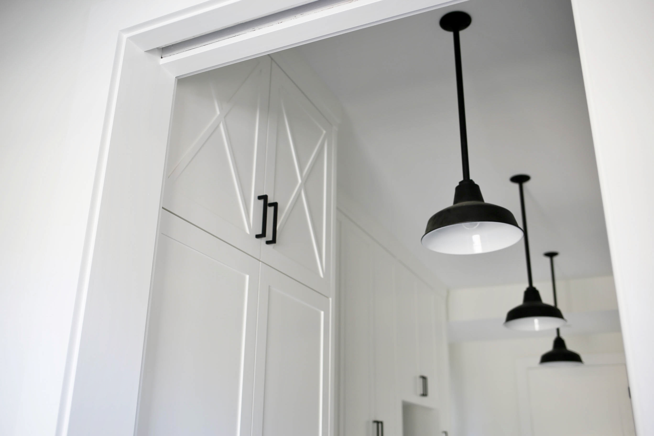 Barn Pendants Highlight Busy Farmhouse Mudroom Inspiration
